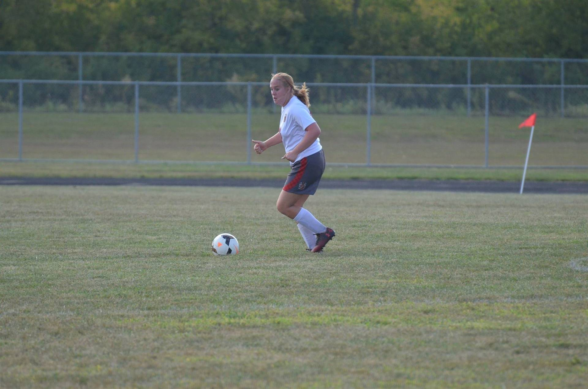 Chey Fout looking to kick the ball up the field.