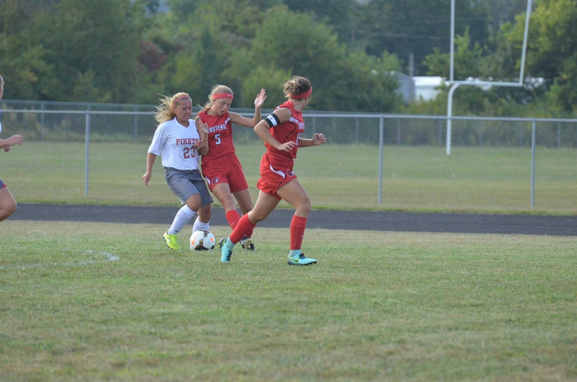Breanna Eick fighting for the ball against one of Eastern Brown's players.