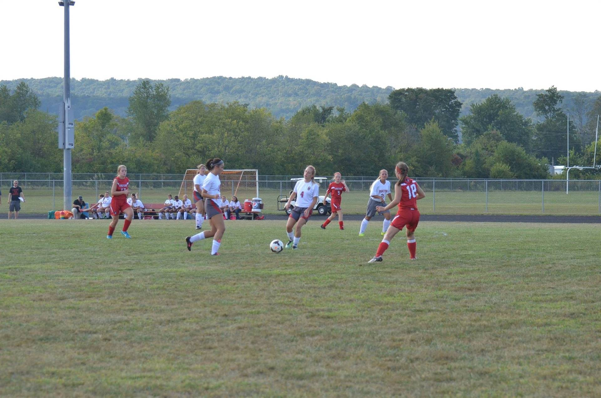 Ally Crothers taking the ball up the field to score a goal.